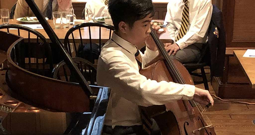 Saint Thomas Choir School student practicing the cello