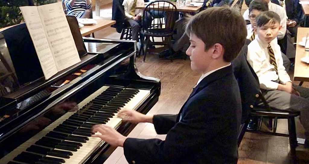 Saint Thomas Choir School student playing the piano