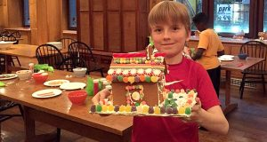 A Saint Thomas Choir School student shares his gingerbread house